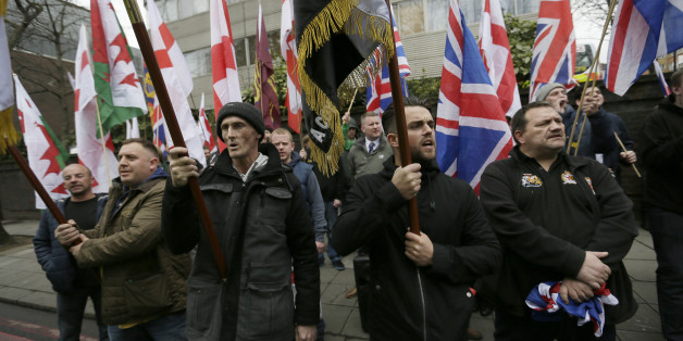 Members of Britain First, a far-right nationalist political party, protest across the street from London Central Mosque during prayers in Regent's Park, London, Friday, April 3, 2015. (AP Photo/Tim Ireland)