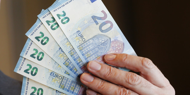 New 20 Euro bank notes are displayed in Frankfurt, Germany, Wednesday, March 4, 2015. The banknote with new security features and different design will be put out in November. (AP Photo/Michael Probst)