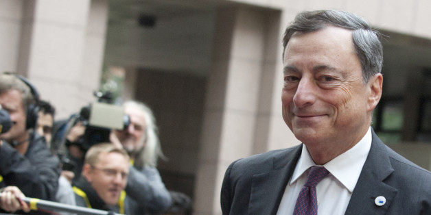 European Central Bank Governor Mario Draghi arrives for a meeting of eurozone heads of state at the EU Council building in Brussels on Sunday, July 12, 2015. Greece has another chance Sunday to convince skeptical European creditors that it can be trusted to enact wide-ranging economic reforms which would safeguard its future in the common euro currency. (AP Photo/Francois Walschaerts)