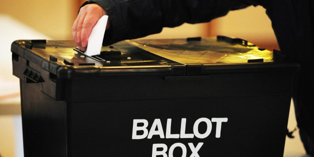 """File photo dated 06/05/10 of a voter placing a ballot paper in a ballot box, as the Government's promised """"tax lock"""" was a key Conservative pledge made in the closing stages of the general election campaign."""