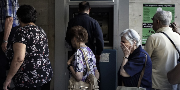 ATHENS, GREECE - JULY 2:  Pensioners line up outside a National Bank branch on July 2, 2015 in Athens, Greece. As people continue to queue outside banks Greek finance minister Yanis Varoufakis said that he will quit if voters don't back him up in Sunday's referendum.  (Photo by Milos Bicanski/Getty Images)