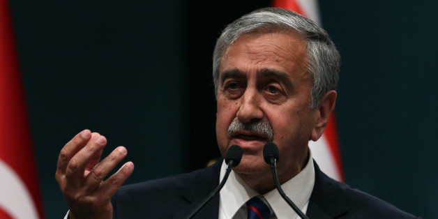 Newly elected Turkish Cypriot leader Mustafa Akinci speaks to the media after talks with Turkish President Recep Tayyip Erdogan in Ankara, Turkey, Wednesday, May 6, 2015. Akinci is in Ankara on a one-day official visit.(AP Photo/Burhan Ozbilici)