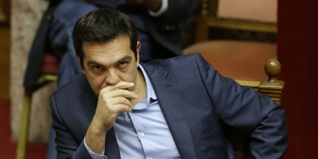 Greece's Prime Minister Alexis Tsipras attends an emergency parliament session in Athens, Wednesday, July 22, 2015. Greece's liquidity-starved banks got a new cash injection from the European Central Bank on Wednesday, hours before a key vote in parliament on further economic reforms demanded by international creditors in return for a third bailout. (AP Photo/Thanassis Stavrakis)