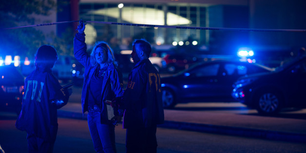 Federal investigators respond to the scene of a shooting at the Grand Theatre on Thursday, July 23, 2015, in Lafayette, La. (AP Photo/Denny Culbert)