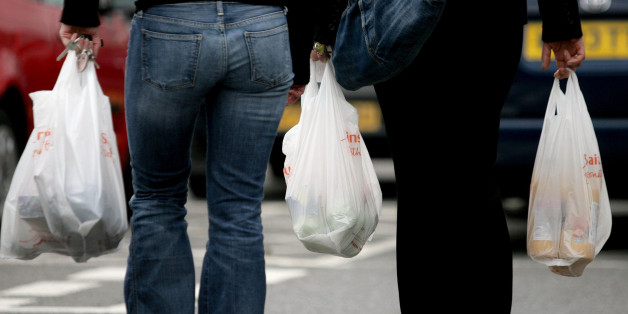 File photo dated 27/09/06 of people carrying plastic bags as the number of single-use plastic bags handed out by UK supermarkets has increased for the fifth year, running to 8.5 billion, figures show.
