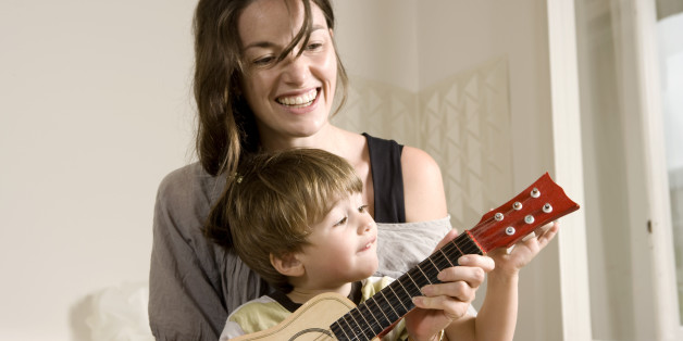 Little Boy and his Mother Playing Guitar