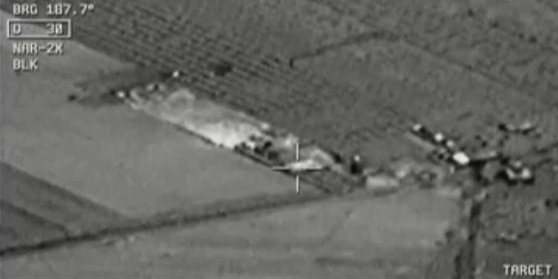 Image from aircraft cockpit video released by Turkey's state-run agency Anadolu Friday, July 24, 2015, of what they report to be Turkish warplanes striking Islamic State group targets across the border in Syria. Black object at centre above target is bomb shortly before impact. Earlier a government official said three F-16 jets took off from Diyarbakir airbase in southeast Turkey early Friday and used smart bombs to hit three IS targets across the Turkish border province from Kilis. The official, who spoke on condition of anonymity because of government rules requiring prior authorisation for comment, said the targets were two command centres and a gathering point of IS supporters. The official said the Turkish planes had not violated Syrian airspace.  (Anadolu via AP Video) TURKEY OUT TV OUT