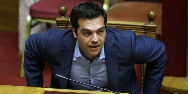 Greece's Prime Minister Alexis Tsipras arrives for an emergency parliament session in Athens, Wednesday, July 22, 2015. Greece's liquidity-starved banks got a new cash injection from the European Central Bank on Wednesday, hours before a key vote in parliament on further economic reforms demanded by international creditors in return for a third bailout. (AP Photo/Thanassis Stavrakis)