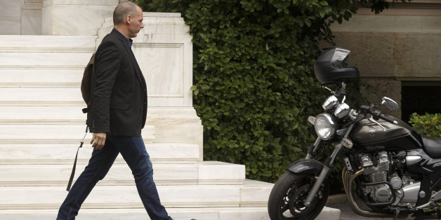 Greek Finance Minister Yanis Varoufakis walks towards his motorbike as he leaves Maximos Mansion in Athens, Sunday, June 28, 2015. Greece is anxiously awaiting a decision by the European Central Bank on whether to increase the emergency liquidity assistance banks can draw on from the country's central bank.(AP Photo/Daniel Ochoa de Olza)