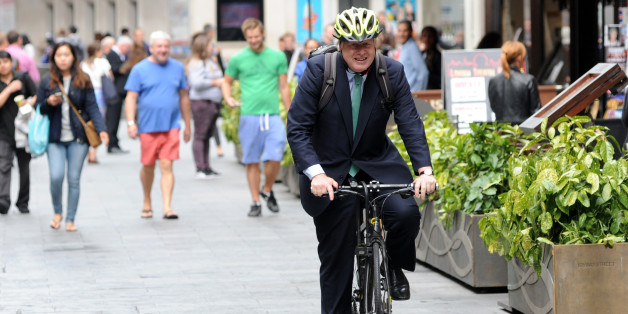LONDON, ENGLAND - JULY 08:  Boris Johnson rides his bicycle outside Global House on July 8, 2015 in London, England.  (Photo by SAV/GC Images)