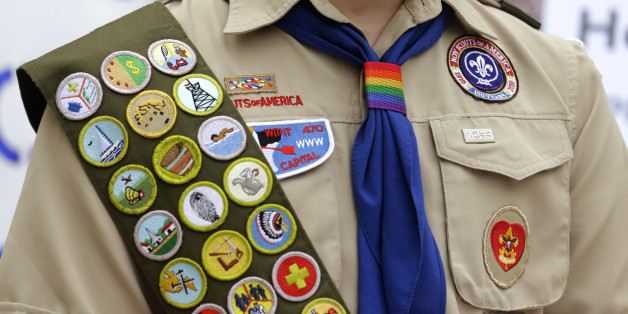 The Boy Scout uniform of Pascal Tessier, 17, a gay Eagle Scout from Kensington, Md., includes his merit badges and a rainbow-colored neckerchief slider, as he speaks in front of a group of Boy Scouts and scout leaders, Wednesday, May 21, 2014, outside the headquarters of Amazon.com in Seattle. The group delivered a petition to Amazon that was started as an online effort by Tessier and gathered more than 125,000 signatures, urging Amazon to stop donating money to the Boy Scouts due to the organiz