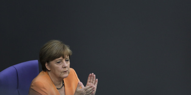 German Chancellor Angela Merkel applauds during a debate  on the Greek financial crisis,  at the German parliament , the Bundestag ,  in Berlin, Wednesday, July 1, 2015. (AP Photo/Markus Schreiber)