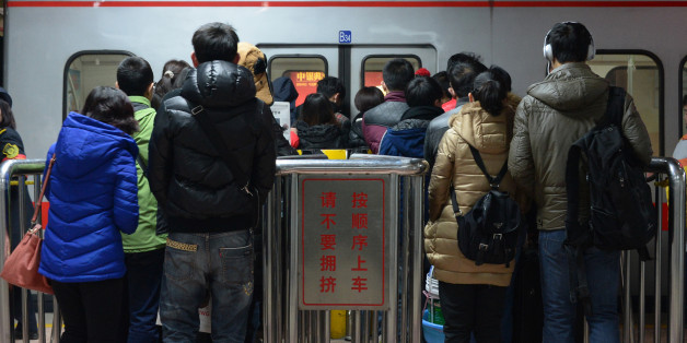 BEIJING, CHINA - DECEMBER 29:  (CHINA OUT) People line up for a subway during the first weekday after the subway adpoted new fare policy at Sihui East Station on December 29, 2014 in Beijing, China. Beijing's subway has adopted new price policy on Sunday. The starting fare for subway rised to 3 RMB (about 0.48 USD) and only cover the first 6 km ride compared with the previous falt-fare 2 RMB (about 0.32 USD) for unlimited transfers. The subway fares will be charged in accordance to the distance you ride which may double the previous prices on average.  (Photo by ChinaFotoPress/ChinaFotoPress via Getty Images)
