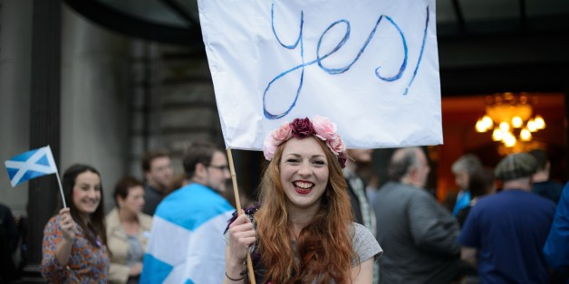 'Yes' campaign supporter waves a flag outside Usher Hall ahead of the 'A Night for Scotland' concert in Edinburgh, Scotland on September 14, 2014. Campaigners for and against Scottish independence raced to win over undecided voters ahead of Thursday's historic referendum, as religious leaders prayed for harmony and music fans gathered for a separatist concert. The Church of Scotland's moderator John Chalmers called for Scots to 'live in harmony with one another' whatever the result and hailed th