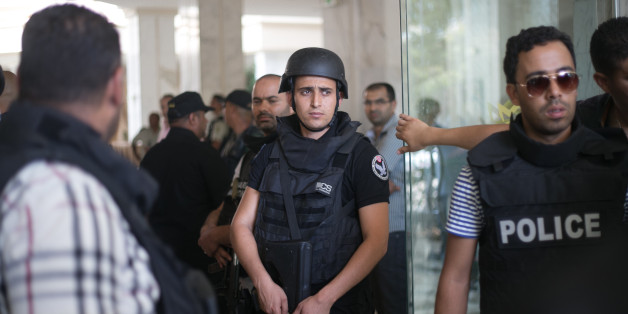 Tunisian police officers stay in the lobby of an hotel where a terrorist attack took place in the coastal town of Sousse, Tunisia, Friday June 26, 2015. A young man unfurled an umbrella and pulled out a Kalashnikov, opening fire on European sunbathers in an attack that killed at least 28 people at a Tunisian beach resort — one of three deadly attacks from Europe to the Middle East on Friday that followed a call to violence by Islamic State extremists. (AP Photo/Leila Khemissi)