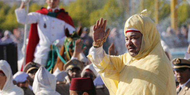 Morocco's King Mohammed VI waves to the crowd as he stands in a limousine during a ceremony of allegiance, at the king's palace in Rabat, Morocco, Thursday July 31, 2014, as part of the ceremonies marking the 15th anniversary of his accession to the throne. (AP Photo/Abdeljalil Bounhar)