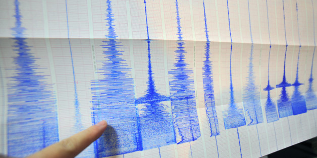 A man points at a seismic chart at the Central Weather Bureau in Taipei on March 4, 2010 after a 6.4 magnitude rocked southern Taiwan near the island's second largest city of Kaohsiung.  The quake hit about 70 kilometres (about 40 miles) from the main southern city of Kaohsiung, the US Geological Survey said, and it was felt as far away as the capital Taipei in the north of the island.   AFP PHOTO / Sam YEH (Photo credit should read SAM YEH/AFP/Getty Images)