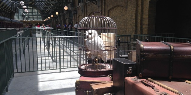 An owl sits amid baggage inside King's Cross Station, part of The Wizarding World of Harry Potter-Diagon Alley, a new park opening July 8 at Universal Orlando Resort in Florida, on Thursday, June 19, 2014. A train ride connects King's Cross with another themed station on the other side of the Universal Orlando theme park where Universal's original Harry Potter attraction opened in 2010. The parks are richly detailed, with settings and characters inspired by the Harry Potter series of books and films. (AP Photo/Tamara Lush)
