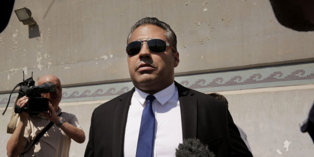 Canadian Al-Jazeera English journalist Mohammed Fahmy, speaks to the media in front of Tora prison, in Cairo, Egypt, Thursday, July 30, 2015. Egyptian judicial officials say a Cairo court has postponed the verdict in the retrial of three Al-Jazeera English reporters until Aug. 2.  (AP Photo/Nariman El-Mofty)