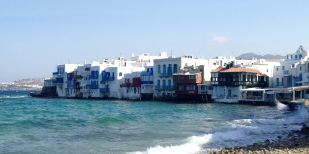 This July 6, 2014 photo shows homes tucked into the waterfront of the island of Mykonos, in an area known as Little Venice. Mykonos is located in the Cyclades, a Greek island chain in the Aegean Sea. The Cyclades are known for panoramic views of the sea, homes tucked into cliffsides and waterfronts, black-sand beaches and dramatic sunsets. (AP Photo/Kristi Eaton)