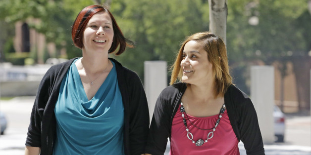 Angie, right, and Kami Roe of West Jordan, arrive at the federal courthouse Wednesday, July 15, 2015, in Salt Lake City. A federal judge has ordered the state of Utah to list the names of the lesbian couple on a birth certificate as the mothers of their new baby. U.S. District Judge Dee Benson said Wednesday the case wasn't hard to decide in the wake of the U.S. Supreme Court ruling legalizing same-sex marriage. (AP Photo/Rick Bowmer)