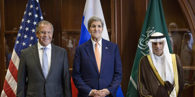 Russia's Foreign Minister Sergey Lavrov, left, US Secretary of State John Kerry, center, and Saudi Foreign Minister Adel al-Jubeir stand together before a trilateral meeting on Monday, Aug. 3, 2015 in Doha, Qatar. Kerry is meeting his Gulf Arab counterparts for talks in Qatar as he attempts to ease the concerns of key allies over the Iran nuclear deal. (Brendan Smialowski/Pool photo via AP)