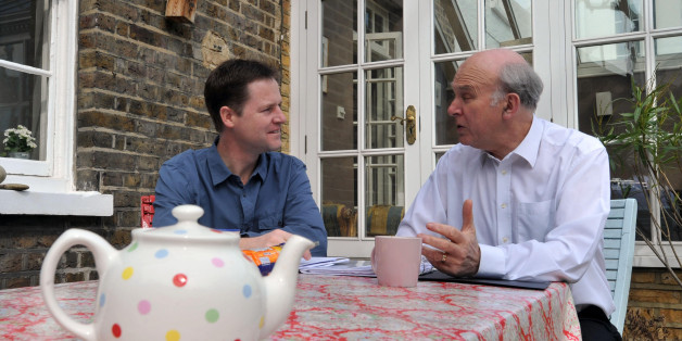 Liberal Democrats Party Leader Nick Clegg and Shadow Chancellor Vince Cable put the finishing touches to the party election manifesto at Mr Clegg's Putney home.