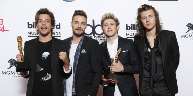 Louis Tomlinson, from left, Liam Payne, Niall Horan, and Harry Styles of the musical group One Direction pose in the press room with the awards for top duo/group and top touring artist at the Billboard Music Awards at the MGM Grand Garden Arena on Sunday, May 17, 2015, in Las Vegas. (Photo by Eric Jamison/Invision/AP)