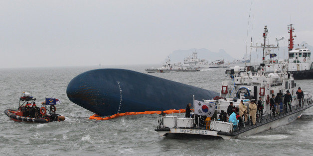 FILE - In this April 17, 2014 file photo, South Korean Coast Guard personnel search for missing passengers aboard the sunken South Korean ferry Sewol in the water off the southern coast near Jindo, South Korea. High school student Cho Eun-hwa, 16, was one of 304 people killed one year ago on Thursday, April 16 in the sinking of the ferry, and among nine whose bodies still have not been recovered. (AP Photo/Ahn Young-joon, File)