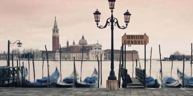 Gondolas docked in urban pier
