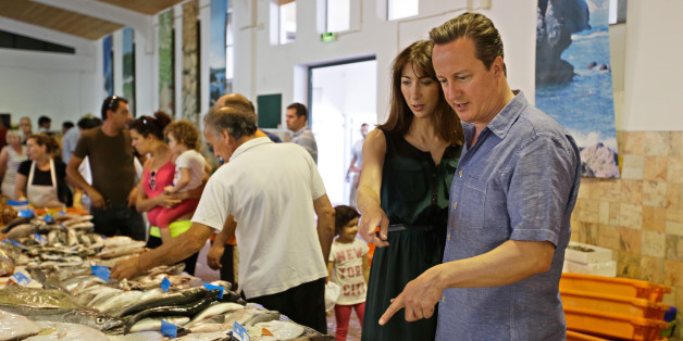 Prime Minister David Cameron and his wife Samantha look at fish in the market of Aljezur, on the southwestern coast of Portugal in 2013