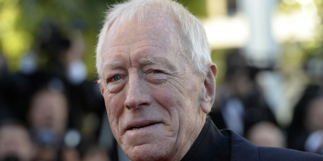 Swedish actor Max von Sydow poses on May 24, 2013 as he arrives for the screening of the film 'The Immigrant' presented in Competition at the 66th edition of the Cannes Film Festival in Cannes. Cannes, one of the world's top film festivals, opened on May 15 and will climax on May 26 with awards selected by a jury headed this year by Hollywood legend Steven Spielberg.   AFP PHOTO / ANNE-CHRISTINE POUJOULAT        (Photo credit should read ANNE-CHRISTINE POUJOULAT/AFP/Getty Images)