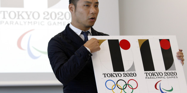 Japanese designer Kenjiro Sano gives a detailed explanation of how he came up with his logo for the 2020 Tokyo Olympics at a press conference in Tokyo, Wednesday, Aug. 5, 2015.  Sano refuted claims Wednesday that he copied the emblem of a Belgian theater when he created the official logo for the 2020 Tokyo Olympics. Belgian designer Olivier Debie has asked the International Olympic Committee and Tokyo Olympic organizers to change the logo because it bears too much resemblance to his emblem for t