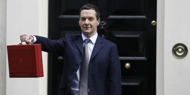Chancellor of the Exchequer George Osborne poses for the media with the traditional red dispatch box outside his official residence at 11 Downing Street in London, Wednesday, March 18, 2015. The Chancellor is to deliver his annual budget speech to the House of Commons later Wednesday. (AP Photo/Kirsty Wigglesworth)