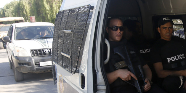 Tunisian police patrol near the attacked Imperial Marhaba hotel in Sousse, Tunisia, Saturday, June 27, 2015. The morning after a lone gunman killed dozens of people at a beach resort in Tunisia, busloads of tourists are heading to the nearby Enfidha-Hammamet airport hoping to return to their home countries. (AP Photo/Darko Vojinovic)