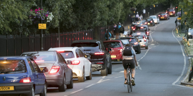 Traffic moves slowly on a road in Wimbledon, south west London, as tennis fans leaving the All England Club faced a difficult journey home due to a Tube strike which will cripple services until Friday morning.