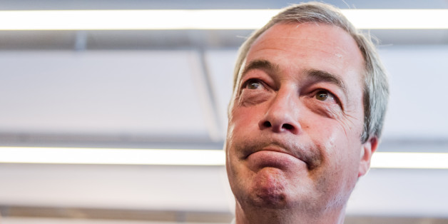 Britain's leader of the UKIP party Nigel Farage speaks with journalists in the press center at an EU summit in Brussels on Thursday, June 25, 2015. (AP Photo/Geert Vanden Wijngaert)