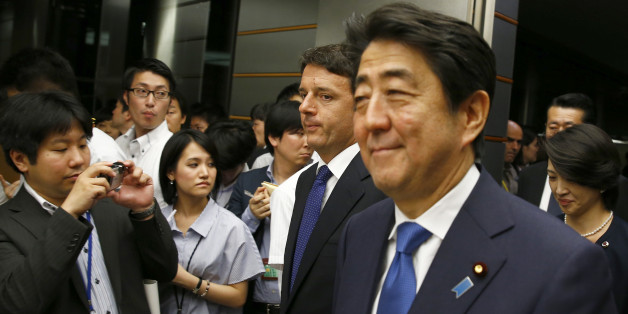 Italian Prime Minister Matteo Renzi, second from right, and his Japanese counterpart Shinzo Abe, right, arrive for a joint news conference following their meeting at Abe's official residence in Tokyo Monday, Aug. 3, 2015. Renzi is on a three-day visit to Japan. (Thomas Peter/Pool Photo via AP)
