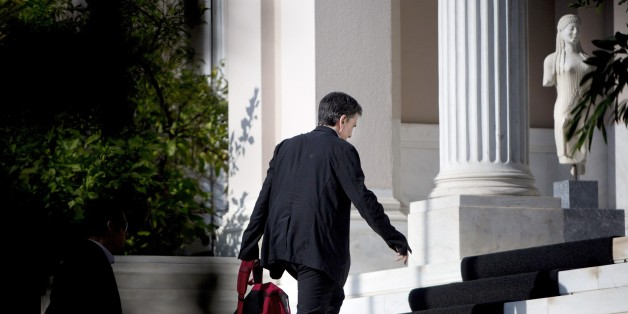 Greek finance minister Euclid Tsakalotos arrives for a cabinet meeting at the Maximos Mansion on August 5, 2105. Greek Prime Minister Alexis Tsipras on July 8 said his government is nearing a deal with international creditors on a mammoth bailout, as his spokeswoman raised the prospect of early elections in the fall. AFP PHOTO / ANGELOS TZORTZINIS        (Photo credit should read ANGELOS TZORTZINIS/AFP/Getty Images)