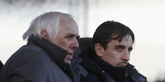Neville Neville (left) and Gary Neville (right) watch in the stands