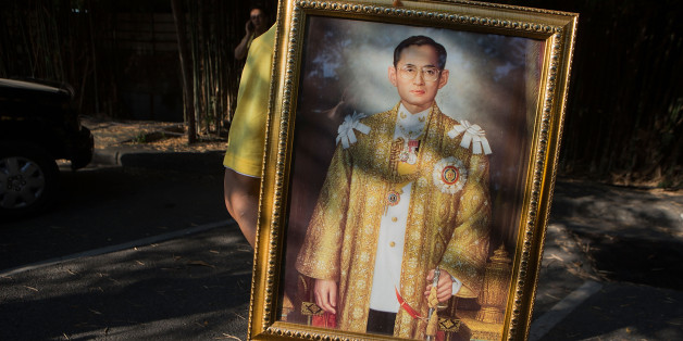 CHIANG MAI, THAILAND - DECEMBER 03:  A Thai man carries a portrait of the King during a parade and ceremony in honor of the King's birthday on December 3, 2014 in Chiang Mai, Thailand. December 5th marks the 87th birthday of King Bhumibol Adulyadej of Thailand, the world's longest reigning monarch.  (Photo by Taylor Weidman/Getty Images)