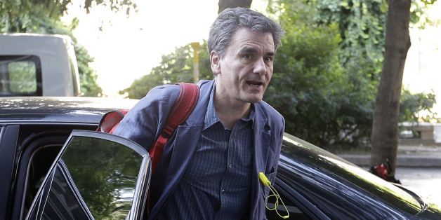 Greece's Finance Minister Euclid Tsakalotos arrives for a meeting at Syriza governing party headquarters in Athens, Tuesday, July 14, 2015. With members of his own party openly denouncing a preliminary rescue deal struck with Greece's European creditors, Prime Minister Alexis Tsipras must fight to cling to his government's majority after he was forced to shred election promises and introduce punishing austerity measures in exchange for the bailout. (AP Photo/Thanassis Stavrakis)