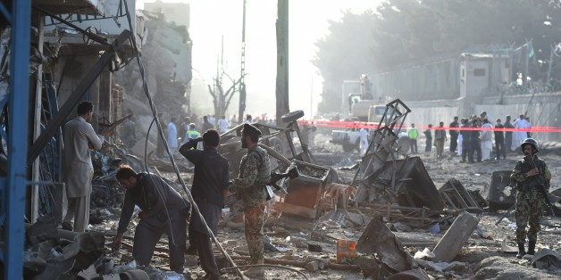 Afghan security forces inspect the site of a powerful truck bomb in Kabul on August 7, 2015.  A powerful truck bomb killed at least seven people and wounded more than 100 others, officials said, the first major attack in the Afghan capital since the announcement of Taliban leader Mullah Omar's death. AFP PHOTO / Wakil Kohsar        (Photo credit should read WAKIL KOHSAR/AFP/Getty Images)