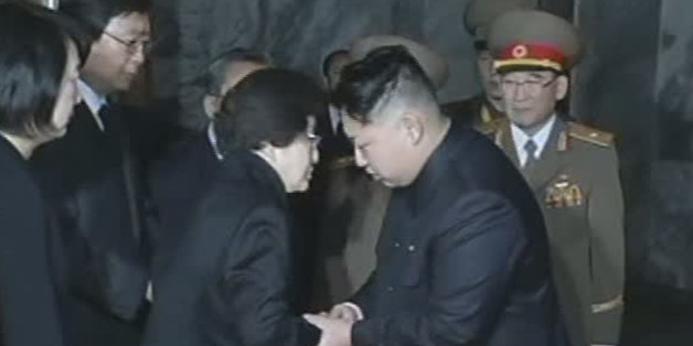 In this Dec. 26, 2011 image made from APTN video, Kim Jong Un, right, late North Korean leader Kim Jong Il's youngest known son and successor, shakes hands with Lee Hee-ho, the wife of former South Korean President Kim Dae-jung who visits Kumsusan Memorial Palace to pay respects to the late leader in Pyongyang, North Korea. (AP Photo/APTN)