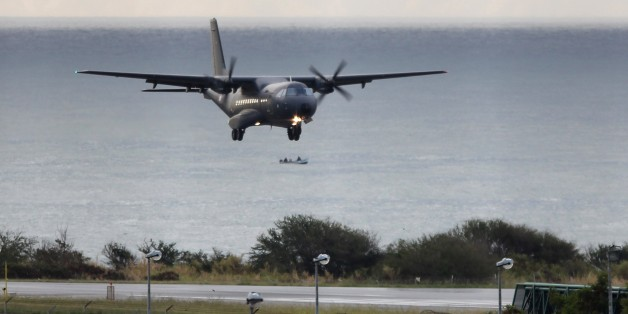 A CASA 235 plane from the 181st Air Detachment of the French Air Force taking part in the search for wreckage from the missing MH370 plane lands in Saint-Marie on the French island of La Reunion on August 7, 2015. France launched a hunt for more wreckage from the ill-fated MH370 plane off Reunion island on August 7 in a fresh effort to shed light on one of aviation's biggest mysteries. AFP PHOTO / RICHARD BOUHET        (Photo credit should read RICHARD BOUHET/AFP/Getty Images)