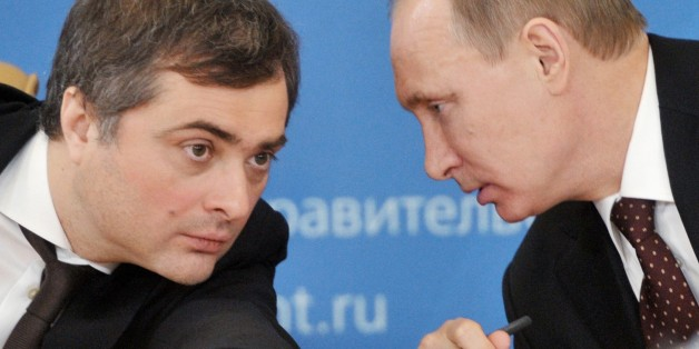 FILE - In this Feb. 13, 2012 file photo, , Russian Prime Minister Vladimir Putin, right, speaks to Vladislav Surkov, deputy prime minister in charge of economic modernization, during a visit in Kurgan, Russia. The United States and its European allies stepped up their pressure on Russia to end its intervention in Ukraine by imposing the most comprehensive sanctions against Russian officials since the Cold War. Surkov is on the list. (AP Photo/RIA Novosti, Alexei Nikolsky, Government Press Service, file)