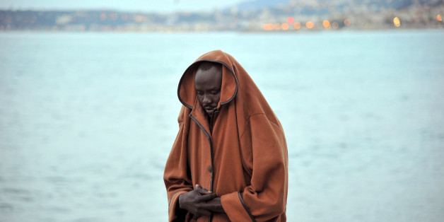 A migrant stands by the sea in Ventimiglia, at the Italian-French border, Tuesday, June 16, 2015. Police at Italy's Mediterranean border with France forcibly removed a few dozen African migrants who have been camping out for days in hopes of continuing their journeys farther north, a violent scene Italy is using to show that Europe needs to do something about the migrant crisis. (Luca Zennaro/ANSA via AP)