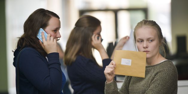 Students at Yate International Academy, South Gloucestershire, open their A-Level exam results, as official figures show that more A-levels were handed the very highest grade this summer, but the overall pass rate fell for the first time in more than 30 years.