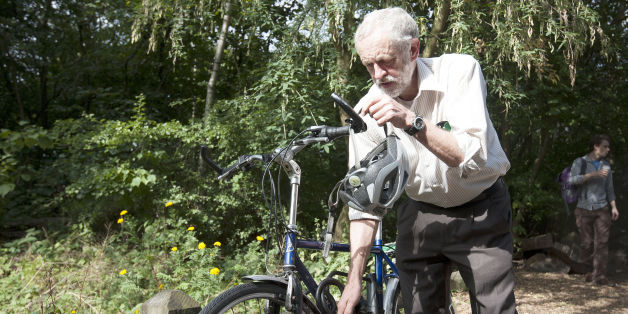 Labour leadership contender Jeremy Corbyn arrives by bicycle to launch his new policies on the environment at Camley Street Natural Park in London