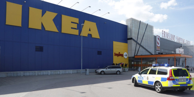 Police officers attend the Ikea store in Vasteras, Sweden, Monday Aug. 10, 2015, after three people were injured in a knife attack at the store. (Peter Kruger/TT via AP) SWEDEN OUT